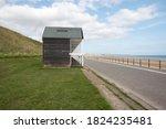 Coastal Beach Huts Next To A...