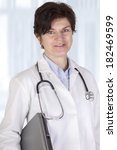 doctor with electronic device | Shutterstock . vector #182469599