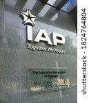 Small photo of The insurance association of Pakistan (IAP) logo on a black tile wall outside their office - Karachi Pakistan - Sep 2020
