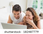 smiling young couple using... | Shutterstock . vector #182487779