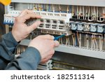 Hands of electrician with...