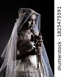 Small photo of Horror Scene of a Possessed bride Woman in white dress black long hair ghost zombie holding dried Rose Bouquet on hand in dark room isolated. halloween scary concept