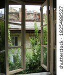 Small photo of Unfavorable area of the city. View from the window of an abandoned house to the neighboring abandoned house.