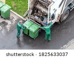 Two workers loading mixed...