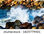 Waves Crashing Onto Rocks On A...