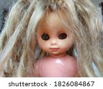 Devilish Scary Doll With A Red...