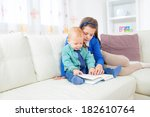 brother and sister sitting in... | Shutterstock . vector #182610764