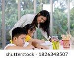 Asian Woman Teacher Teaching...