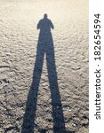 long shadow of the man standing ... | Shutterstock . vector #182654594