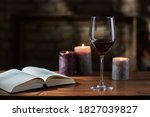 Glass Of Red Wine  Open Book...