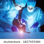 Small photo of Two doctors perform laser surgery to treat varicose veins and hemorrhoids. Concept laser surgery