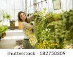 young woman in flower garden | Shutterstock . vector #182750309