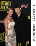 Постер, плакат: Lara Bingle Sam Worthington