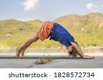 Boy Doing Yoga On A Yoga Mat...