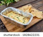 cheesy baked nachos on a...