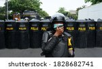Small photo of Tangerang, Indonesia - October 7, 2020 - Police officers guard the action of Tangerang workers in rejecting the ratification of the Work Creation Bill in the Omnibus Law.