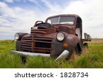 A Rusty Old Pickup Truck Sits...