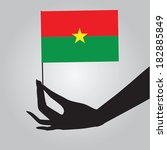 burkina faso flag in his hand....