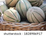 A Basket Of Cantaloupe Sit For...
