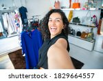 Cheerful Excited Latin Woman...