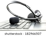 headset lying on a laptop... | Shutterstock . vector #182966507