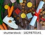 Dutch holiday Sinterklaas background with children shoe, carrots for Santa