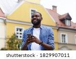 Happy Man Using Mobile Phone...
