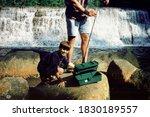 Young Boy Fishing At A River ...