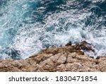 Sea Wave Crashing On Rocks Of...