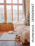 A Cozy  Bright Bedroom With Ne...