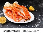 Crab Legs In A Plate On A Dark...