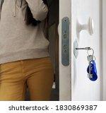 woman stands in the doorway... | Shutterstock . vector #1830869387
