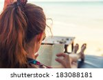 Young Woman Reading A Book At...