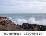 Waves Hitting Land In The...