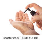Small photo of a man squeezes antiseptic gel from a transparent plastic bottle onto his hands on a white background. concept of counteracting the virus, clean hands. copy space
