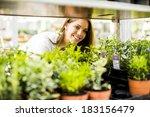 young woman in flower garden | Shutterstock . vector #183156479