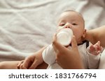 Baby Eats Milk From A Bottle...