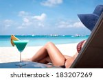 Woman In Hat Sitting In Chaise...