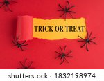 Top above overhead view photo of torn halloween red paper over yellow background with decorative spiders