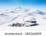 Skiers On Ski Slopes In  Alp...