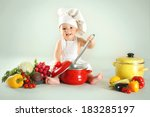 Baby Wearing A Chef Hat With...