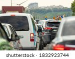 Small photo of Highway interstate road with car traffic jam and Kiev on background. Motorway bumber barrier gridlock due country border control point. Vehicle crash accident and queue bottleneck on freeway