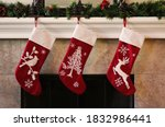 Three red christmas stockings...