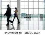 people silhouette in hall of... | Shutterstock . vector #183301634