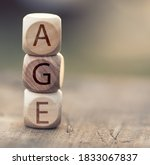 the word age on wooden cubes | Shutterstock . vector #1833067837