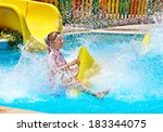 child on water slide at... | Shutterstock . vector #183344075