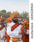 Small photo of BIKANER, RAJASTHAN, INDIA - JANUARY 11, 2020: Indian military bagpipers band playing bagpipe during Camel festival in Rajasthan state