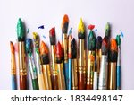 Brushes With Colorful Paints On ...