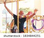 Smiling Senior Man On Horse...