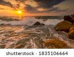 A Sunset Ocean Wave Is Breaking ...